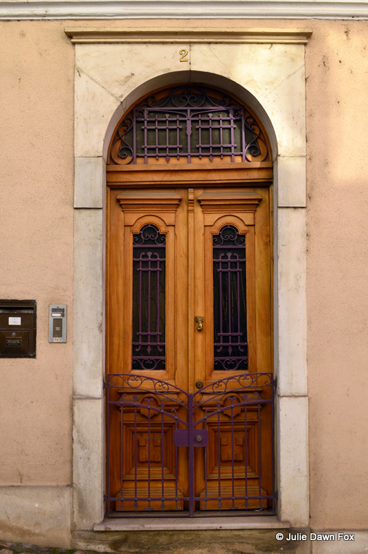 Wooden door with purple railings