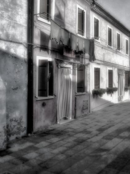 door and laundry in burano Italy