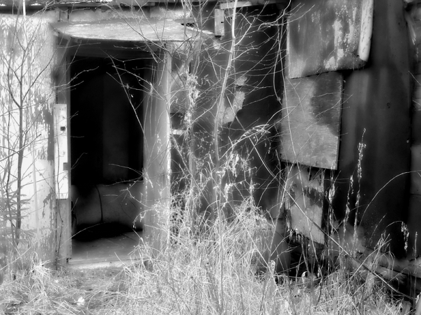 dilapidated dor of abandoned building black and white