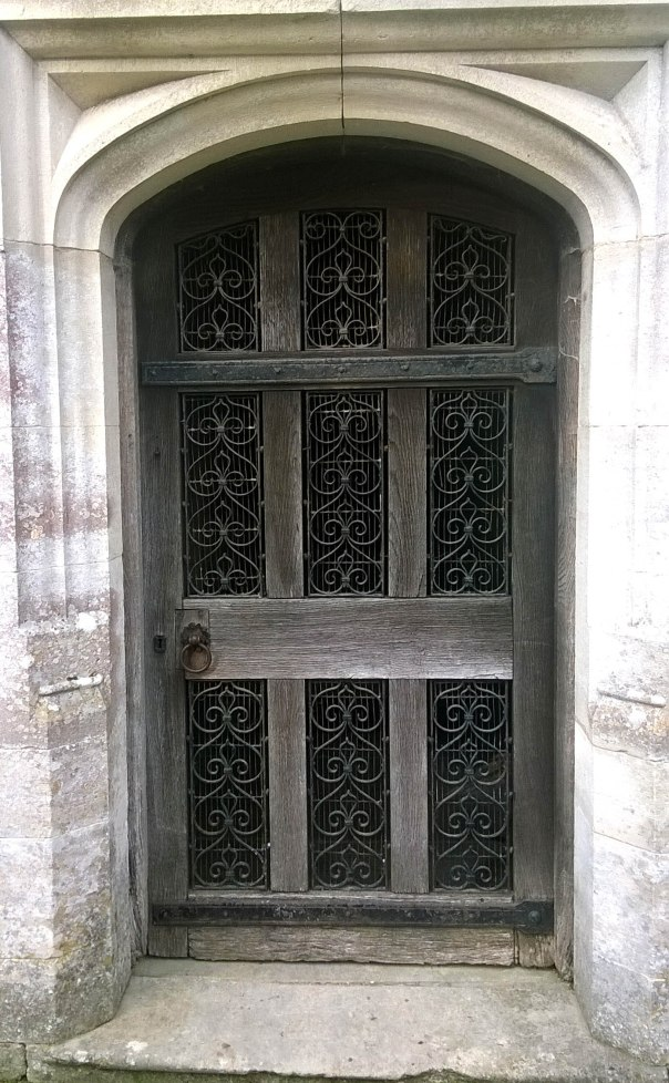 Wooden and Iron Door of Church in Stoughton, West Sussex UK
