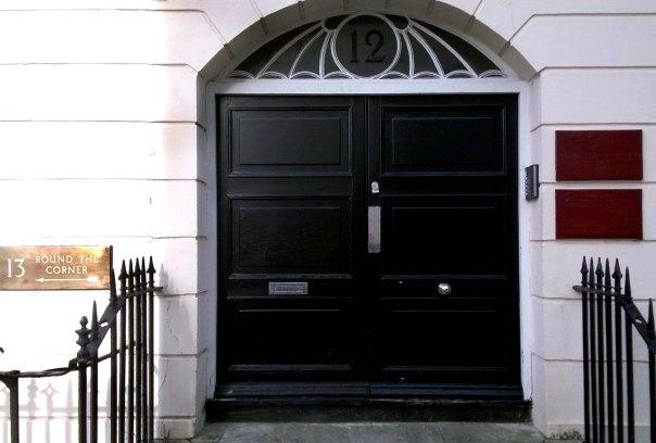 Black door with window above like bats wings.