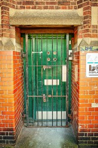 Peep Holes Behind Bars-Door