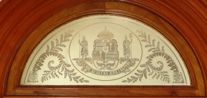 Crest above a glass door, Iolani Palace